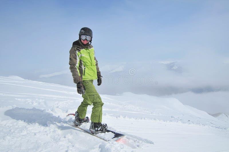 Sports d'hiver (verticale de snowboarder) images stock