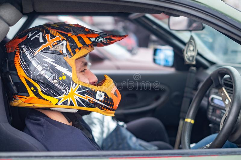 Sports driver in helmet before race start stock photo