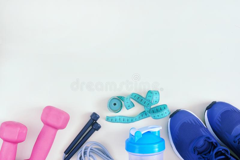 The sports equipment is on the bottom on an empty light background. A layout with space for text. Mock up. stock image