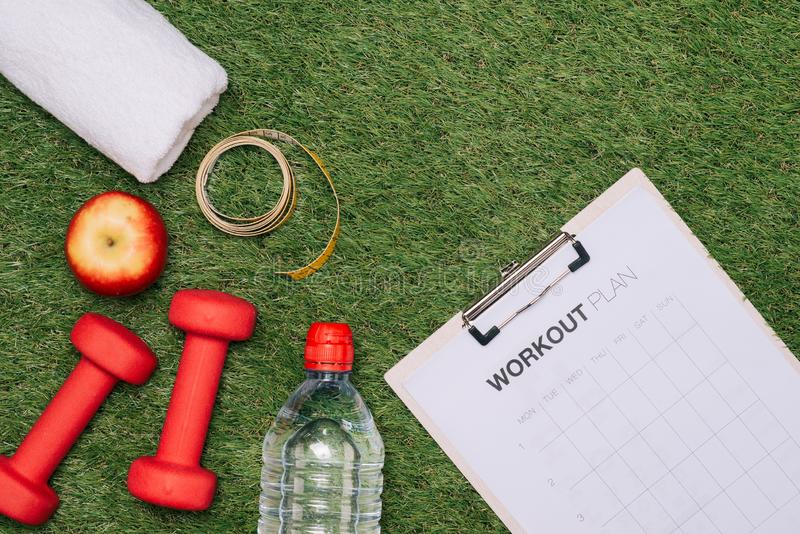Sports equipment on green grass background.  royalty free stock images