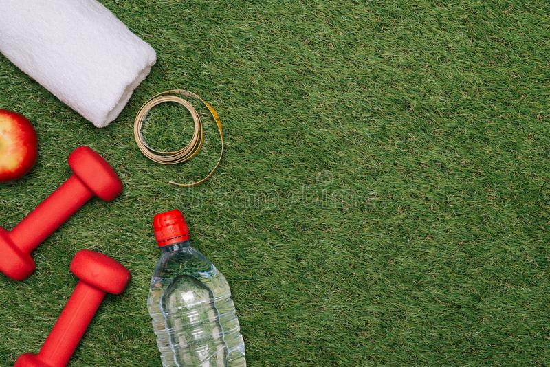 Sports equipment on green grass background.  stock photos