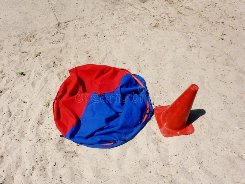 Sports equipment, prepared for competitions, lying on the sand.  royalty free stock photography