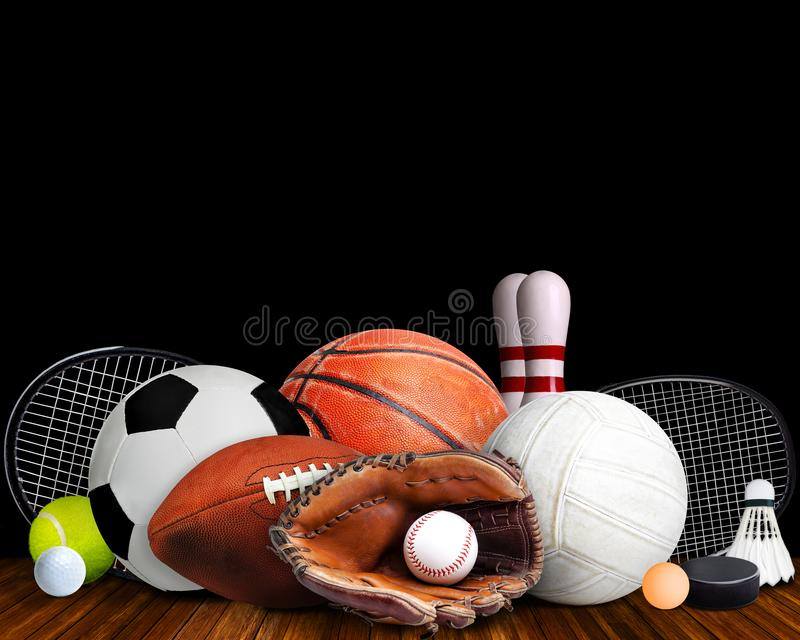 Sports Equipment, Rackets and Balls Isolated on Black Background. Sports equipment, rackets and balls on table with black background and copy space royalty free stock image