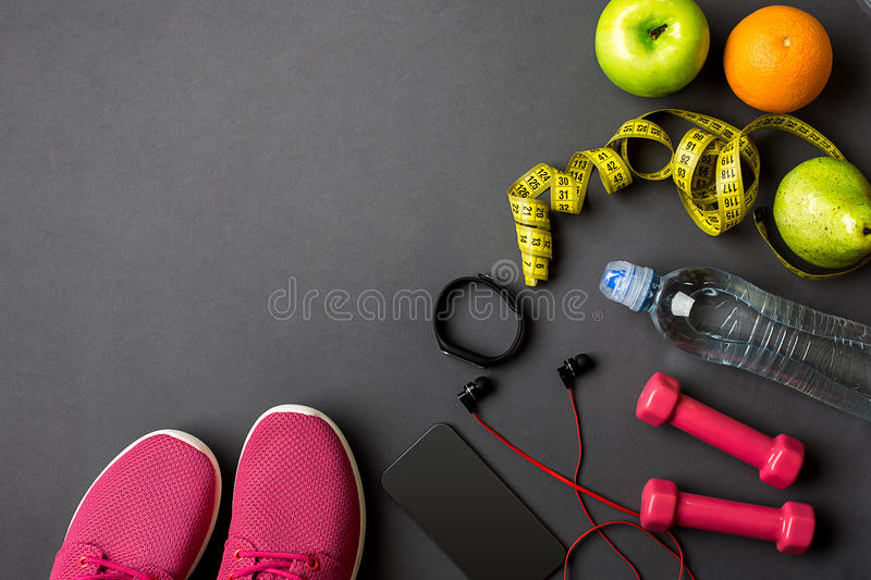 Sports equipment and wear on gray table, top view royalty free stock images