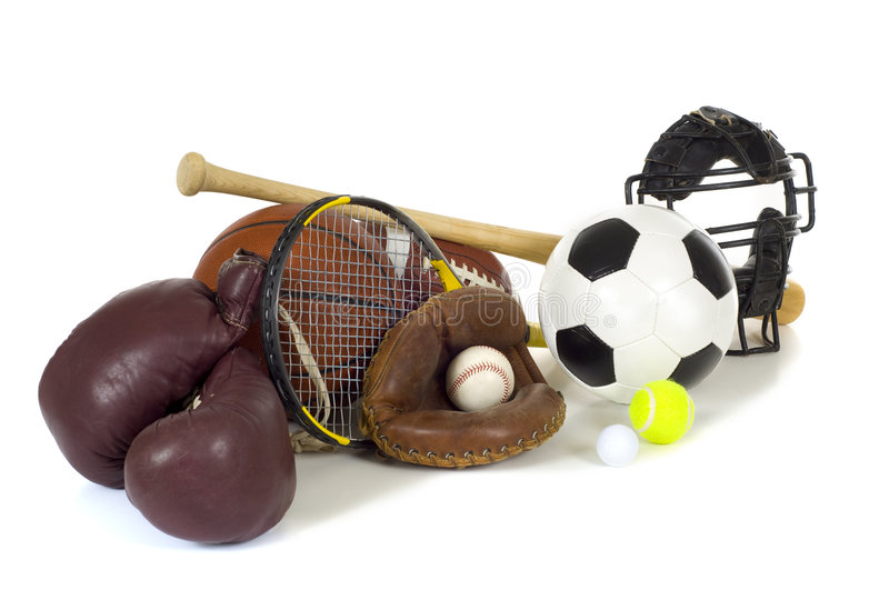 Sports Equipment on White. Variety of sports equipment on white background with copy space, items inlcude boxing gloves, a basketball, a soccer ball, a football stock photography
