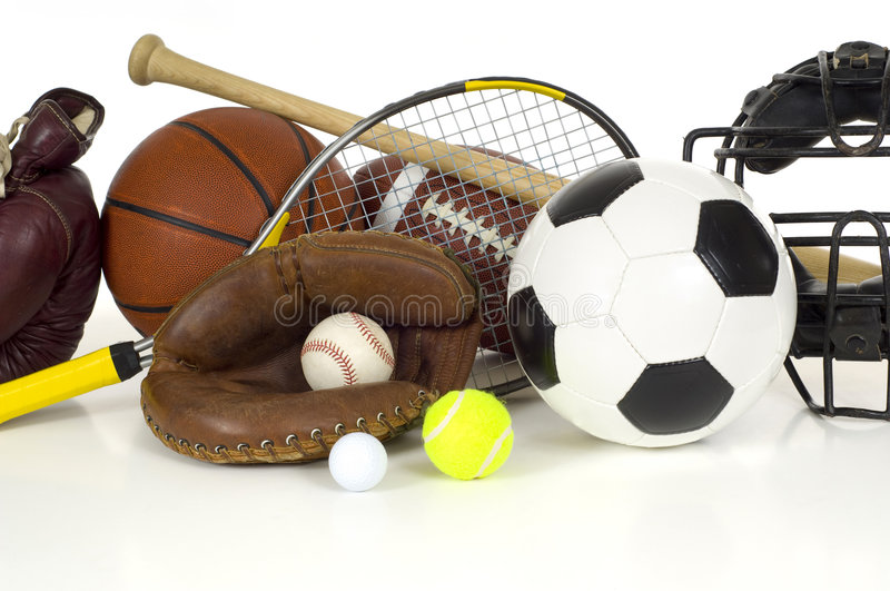 Sports Equipment on White. Variety of sports equipment on white background with copy space, items inlcude boxing gloves, a basketball, a soccer ball, a football stock photos