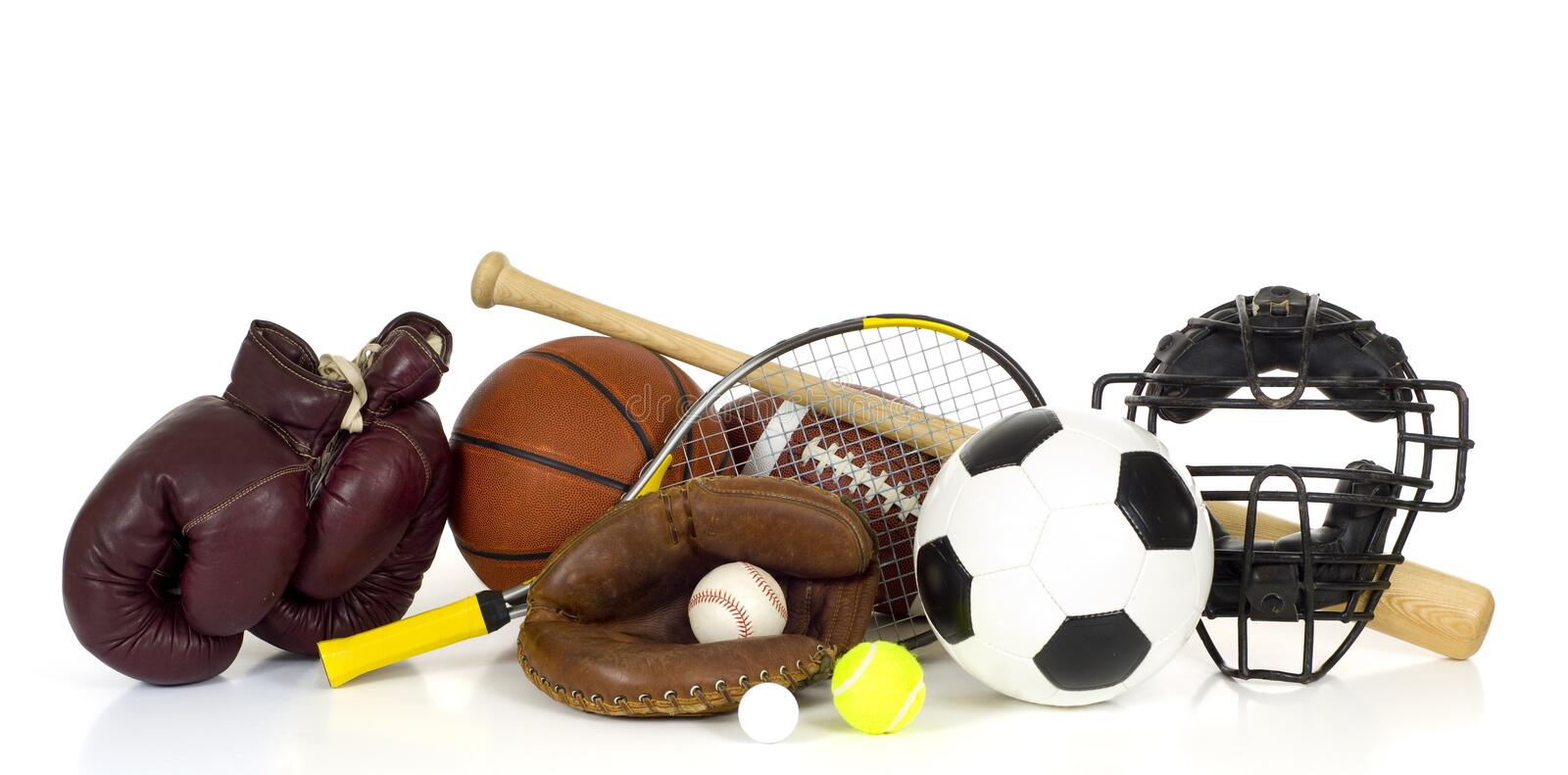 Sports Equipment on White. Variety of sports equipment on white background with copy space, items inlcude boxing gloves, a basketball, a soccer ball, a football royalty free stock photography