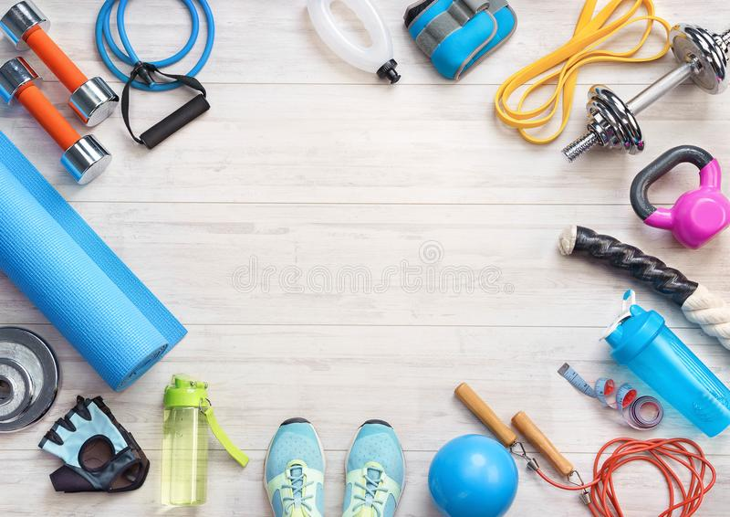 Sports equipment on a white wooden background. Top view. Motivation. Ð¡opy space royalty free stock images