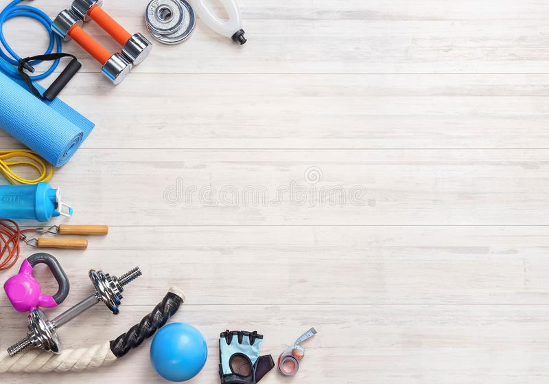 Sports equipment on a white wooden background. Top view. Motivation. Ð¡opy space stock photos