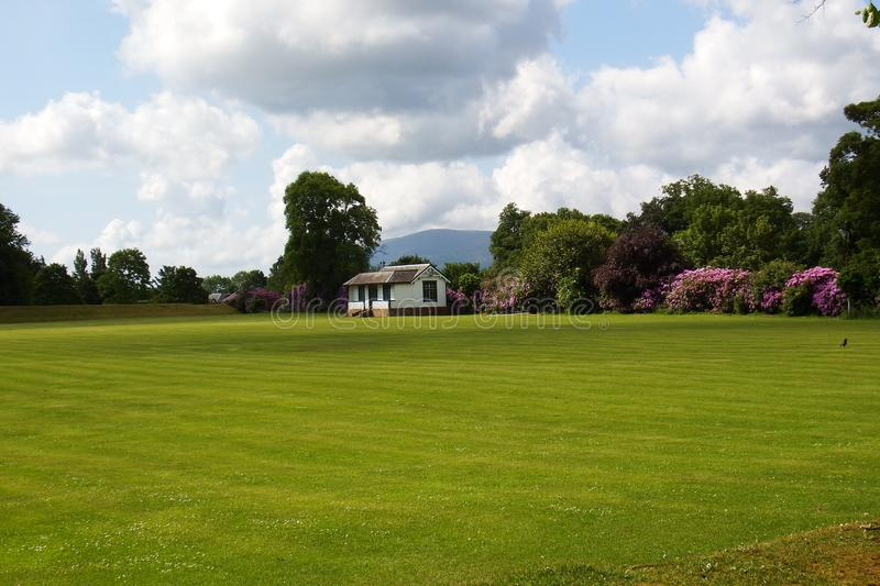 Cricket Pavilion. A sports field and cricket green and pavilion club house royalty free stock photos