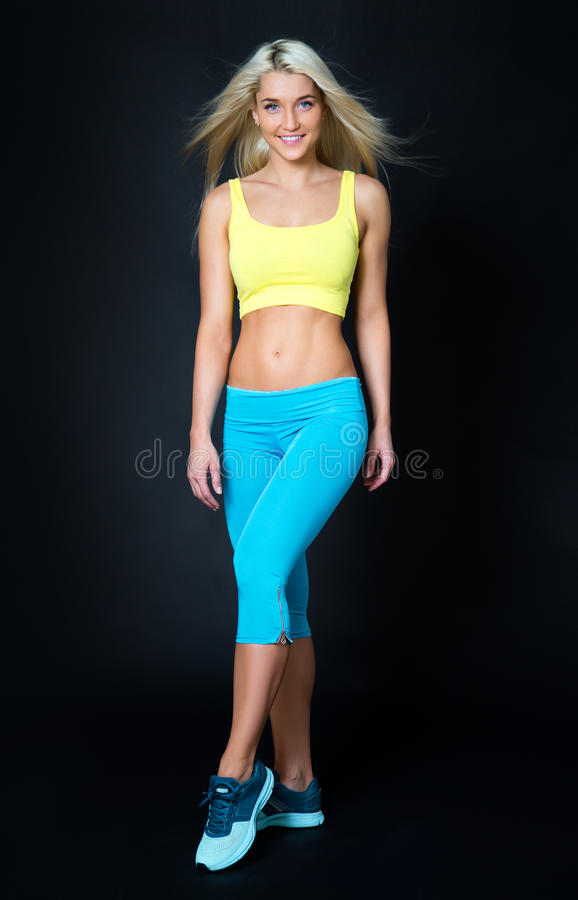 Sports girl on a black stock photography