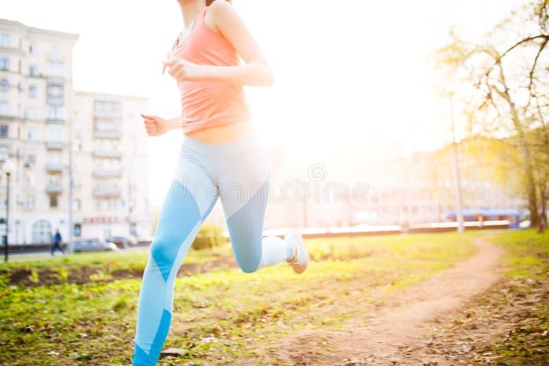 Sports girl on morning run stock photos