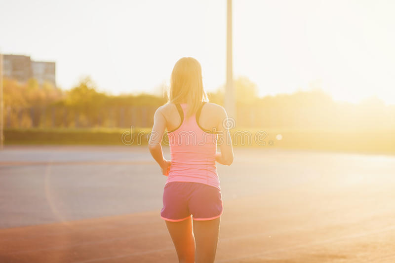 Sports girl running royalty free stock images