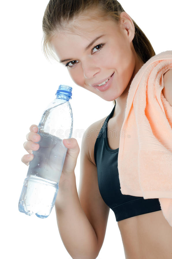 The Sports Girl With A Towel And A Water Bottle Royalty Free Stock Photography