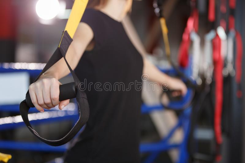 A sports girl is training with a tape stock photo