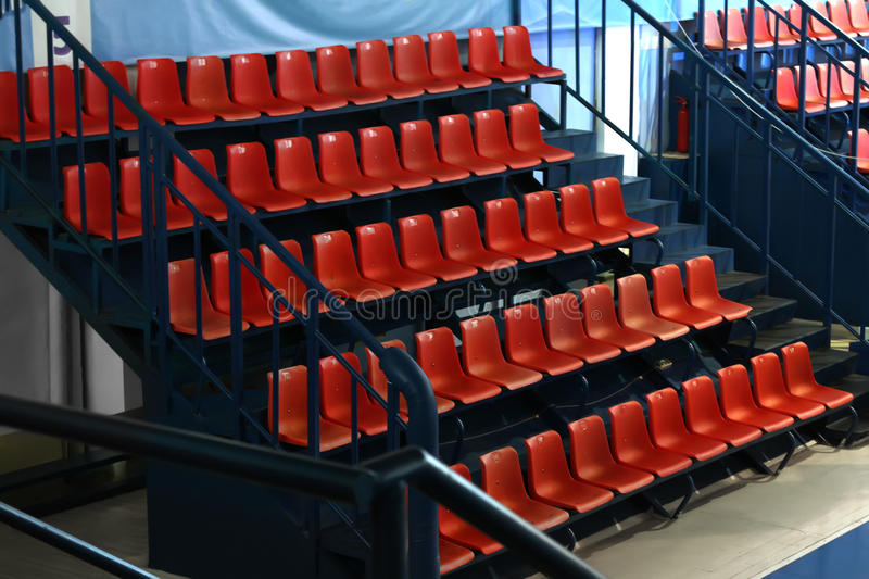 Sports grandstand. A sports grandstand with red chairs royalty free stock photos