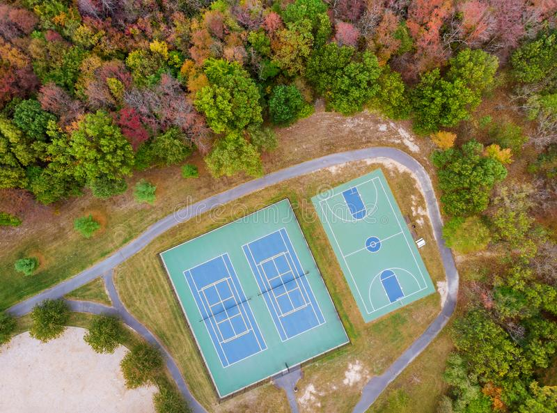 Autumn landscape view sports ground a height basketball and tennis playing field. Sports ground a height basketball and tennis playing field autumn landscape stock photo