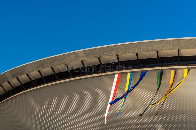 Sports hall Spodek. Built in a shape of flying saucer, on September 08, 2013, in Katowice, Poland, decorated with the flags on the occasion of The International royalty free stock image