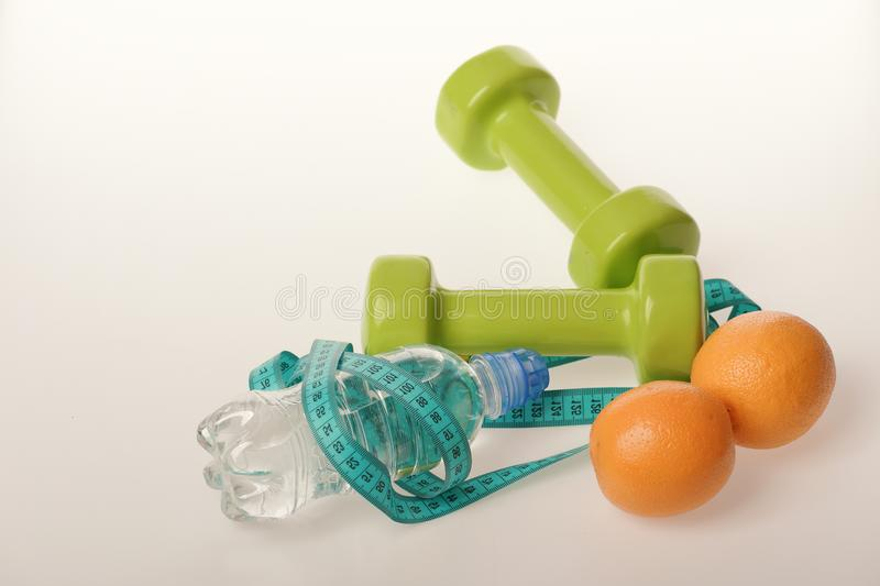 Sports and healthy regime, copy space. Dumbbells in green color stock photos