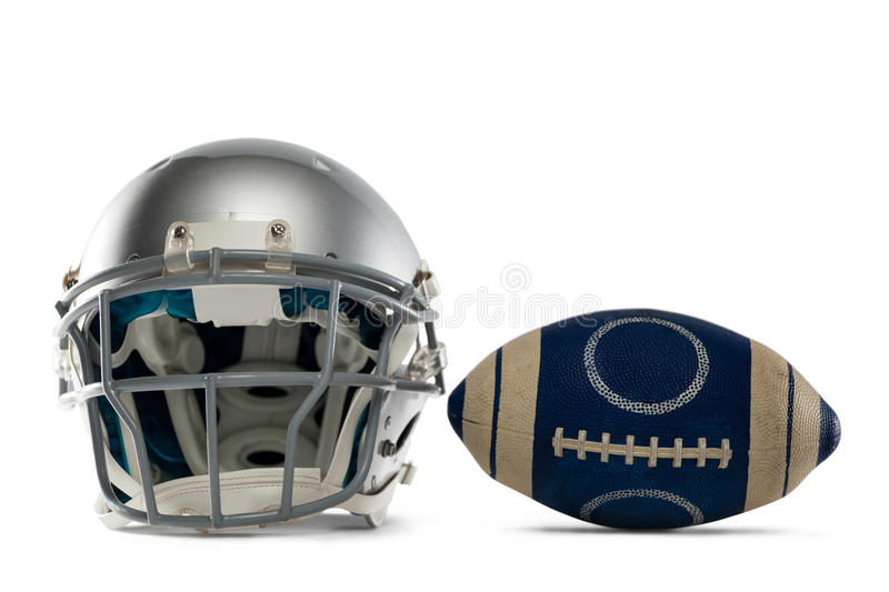 Sports helmet and American football. Against white background stock image