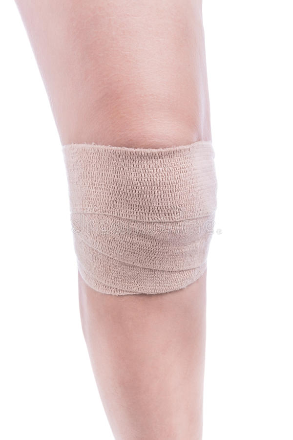 Sports injuries of the knee. Bandage elastic tied. stock photos