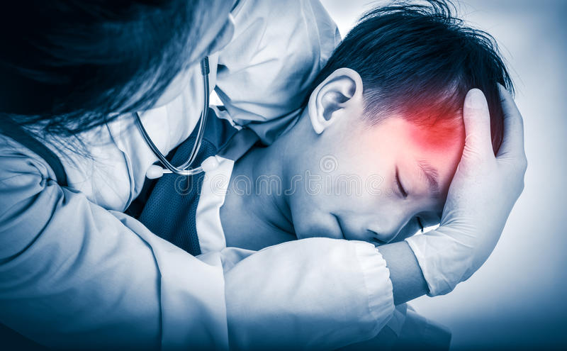 Sports injury. Doctor give first aid at child& x27;s temple with bruise. royalty free stock photo