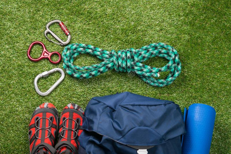 Sports kit for extreme recreation in the wild, on a green lawn, for mountaineering stock photos