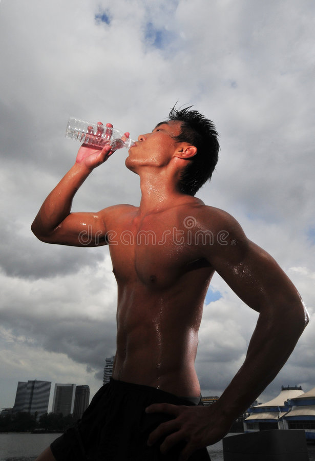 Sports Man quenching his thirst after a workout stock photos