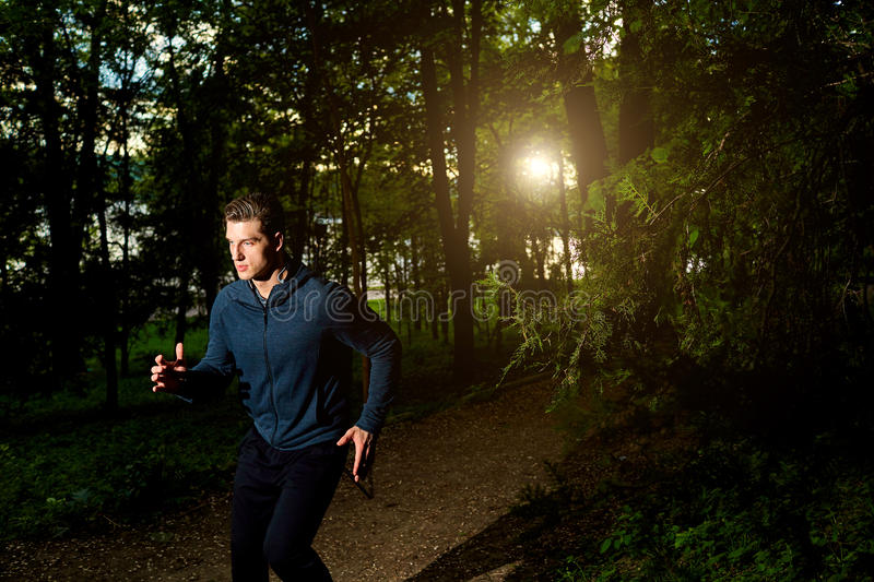 Sports man running at night. Lifestyle.Sportsman stock image