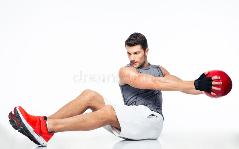 Sports man working out with fitness ball. Isolated on a white background stock photography