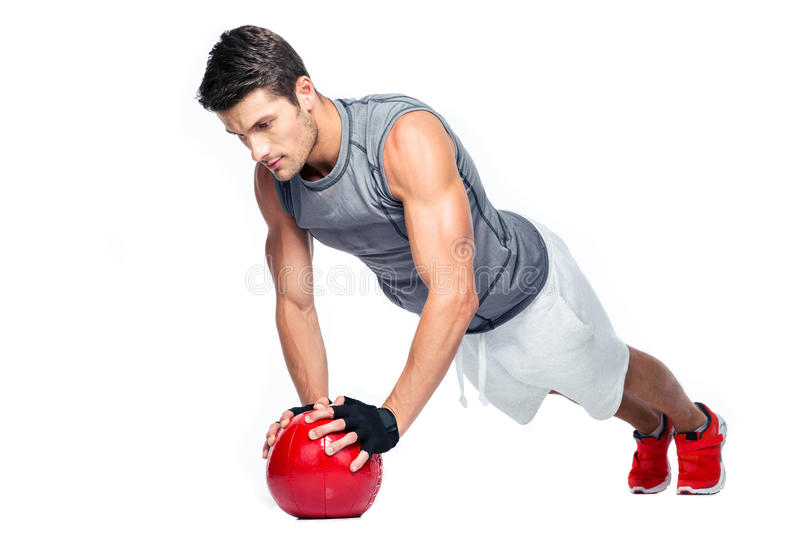 Sports man working out with fitness ball. On a white background stock image