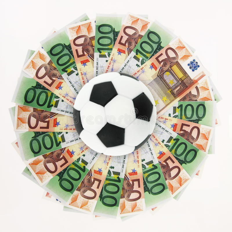 Sports and money. Football and money on white background royalty free stock images