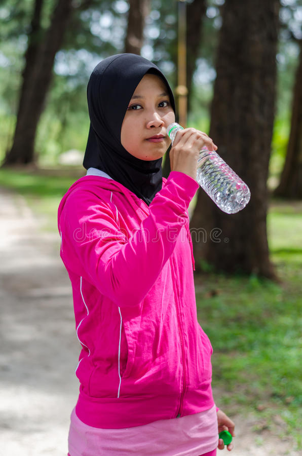 Sports Muslimah Woman. Sport Muslimah Women Concept at Garden Park stock photo