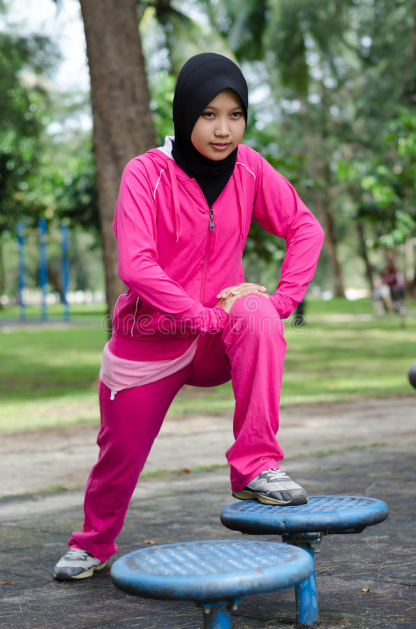 Sports Muslimah Woman. Sport Muslimah Women Concept at Garden Park stock photography