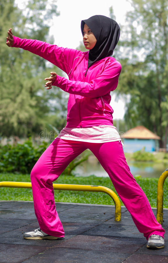 Sports Muslimah Woman. Sport Muslimah Women Concept at Garden Park royalty free stock image