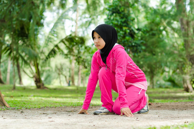 Sports Muslimah Woman. Sport Muslimah Women Concept at Garden Park royalty free stock photos