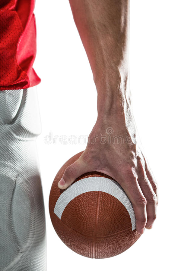 Sports player holding ball stock photo