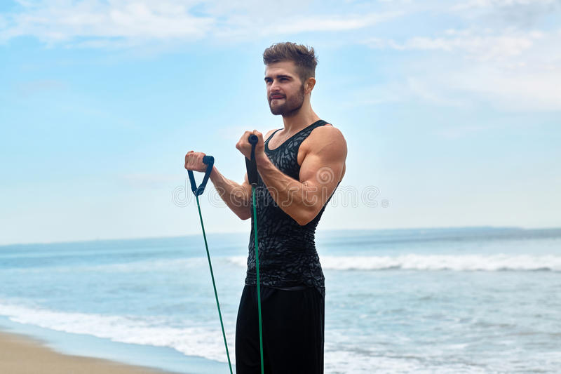Sports. Portrait Of Man Exercising At Beach During Outdoor Workout stock photography