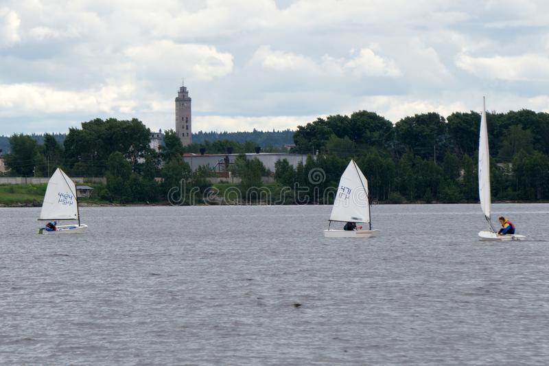 Sports sailing in Lots of Small white boats on the lake . stock photos