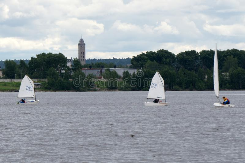 Sports sailing in Lots of Small white boats on the lake . royalty free stock photo