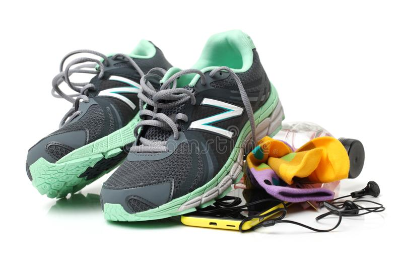Sports shoes and gym accessorie royalty free stock images
