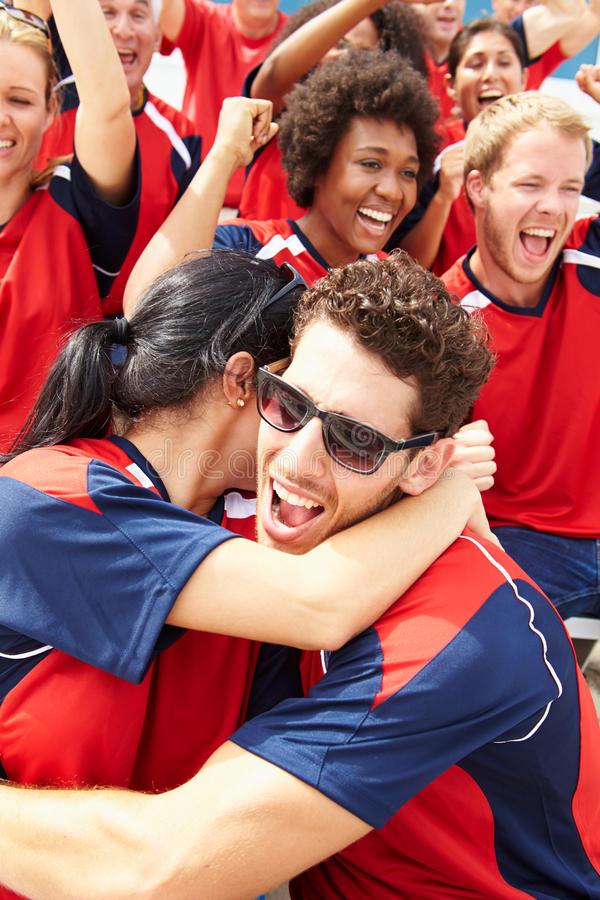 Sports Spectators In Team Colors Celebrating royalty free stock image