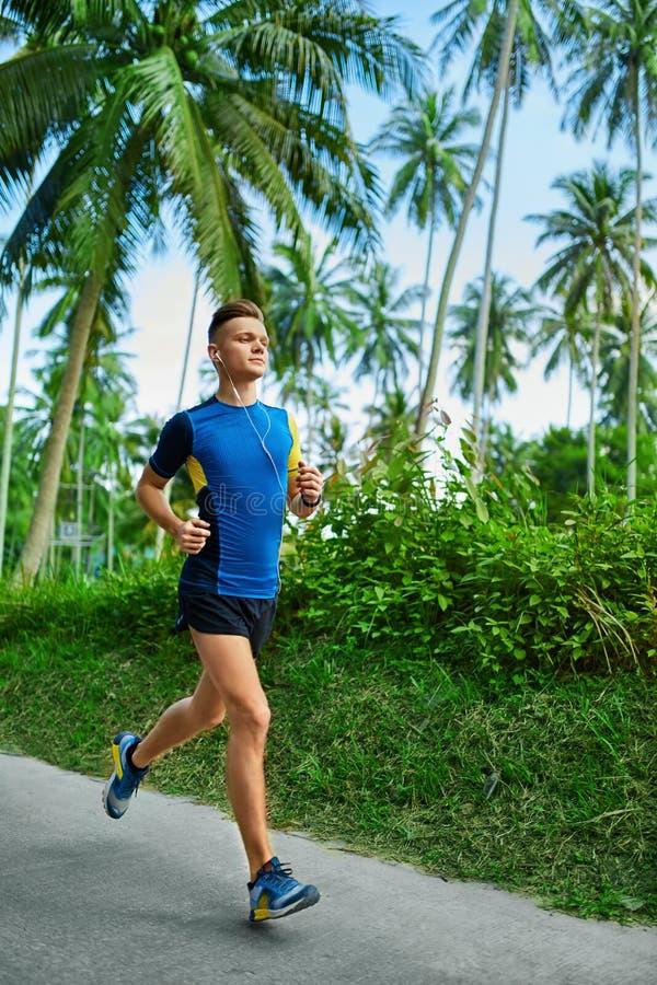 Sports. Sporty Runner Running. Jogger Training, Jogging. Fitness. Sports. Sporty Young Male Runner Running On Road. Jogger Training For Marathon Run. Athletic stock image