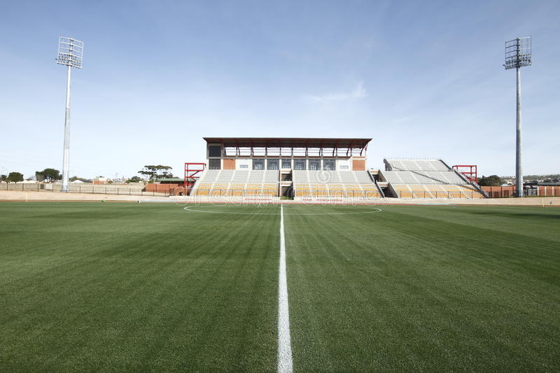 Sports stadium with green grass royalty free stock photo