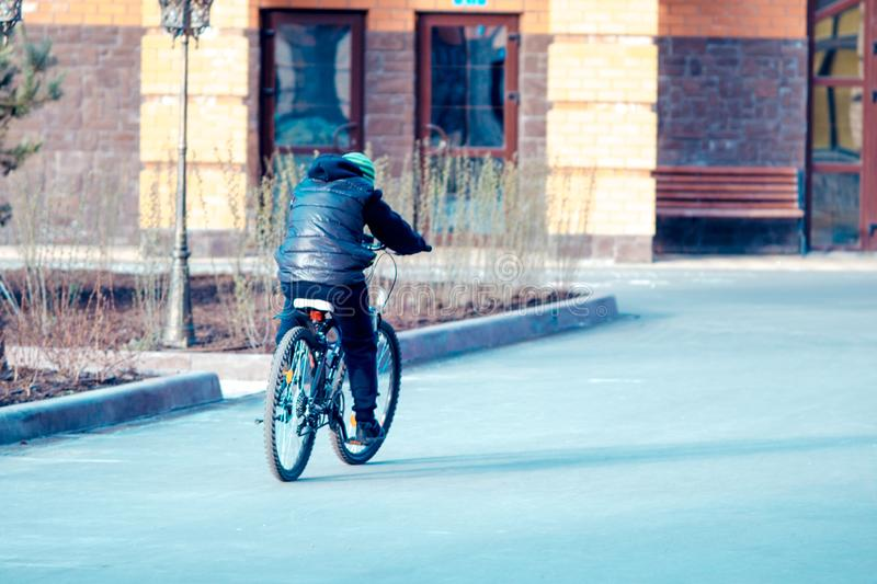 Sports in the stone jungle. boy riding bicycles for a walk royalty free stock photos