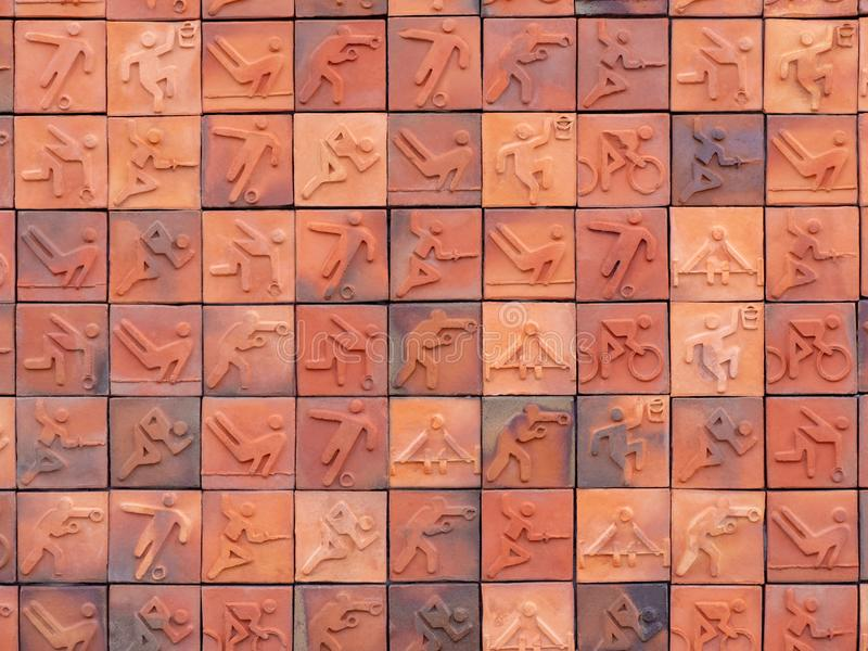 Sports symbols on ceramic mosaic background. Close up shot of sports symbols on ceramic mosaic background stock images