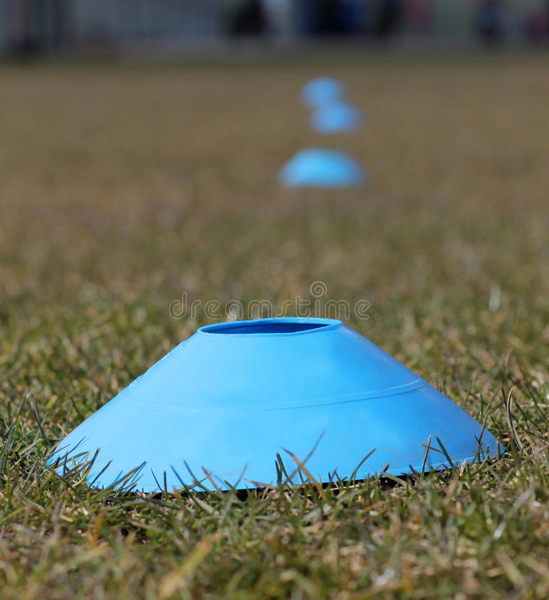 Sports training cones on soccer pitch. Sports training cones on soccer or football pitch royalty free stock images