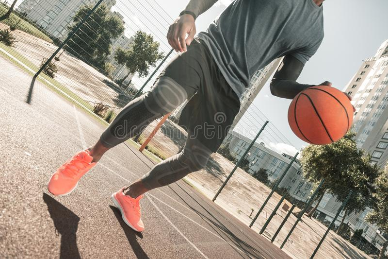 Well built nice man playing basketball alone stock photography