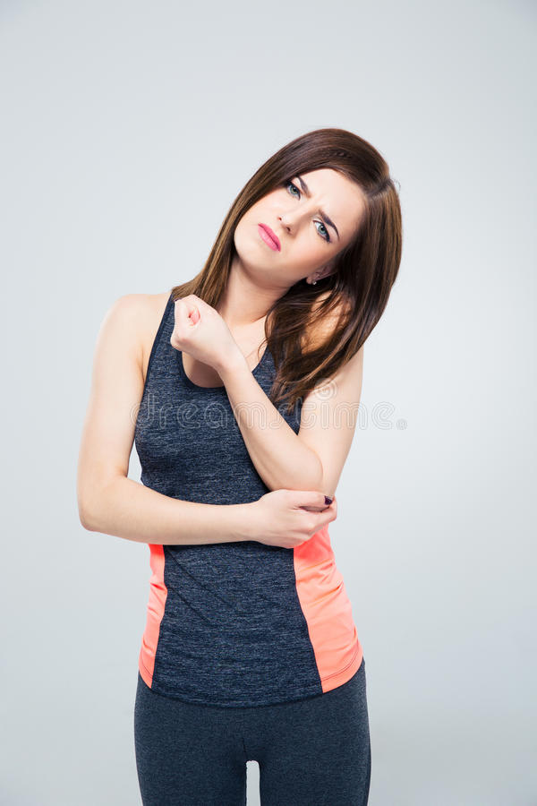 Sports woman having pain in elbow royalty free stock photos