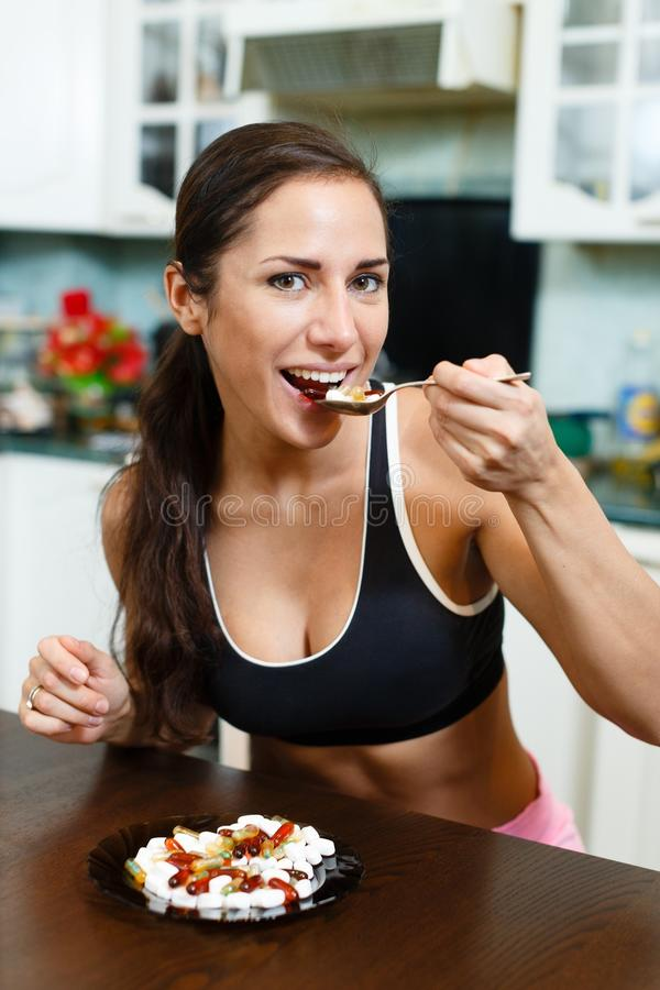 Sports woman and nutritional supplements. royalty free stock photo